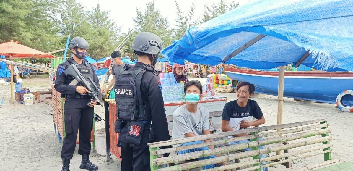Satbrimobda Polda Bengkulu Tak Bosan Ingatkan Masyarakat Patuhi Prokes Covid-19