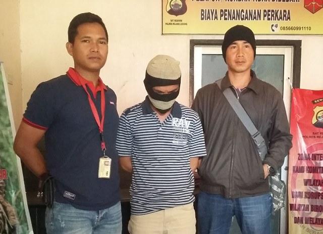 Polisi Tangkap Penyebar Poto Mesum