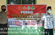 Himbau Prokes, Bhabinkamtibmas Polres Lebong Pasang Spanduk PPKM